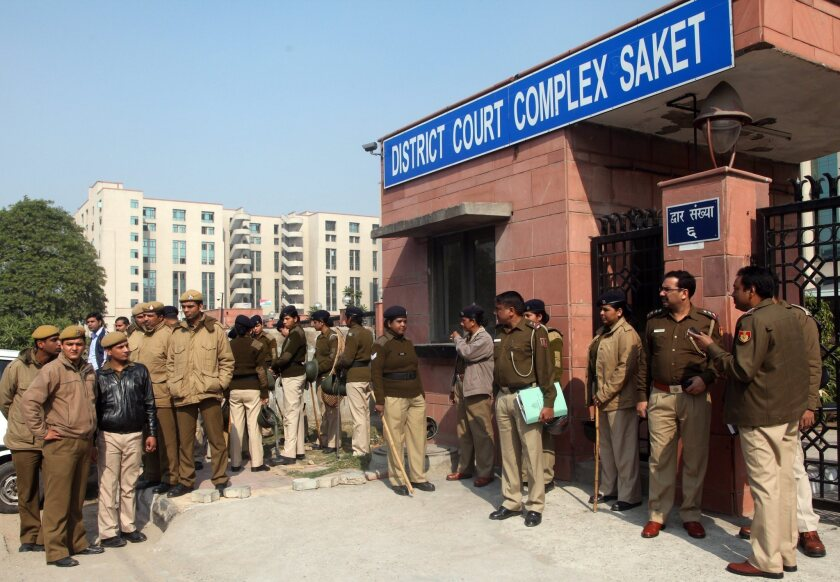 Police gather outside the Saket district court complex in New Delhi on Thursday as a hearing begins in the case of five men accused of gang-raping and killing a 23-year-old student.