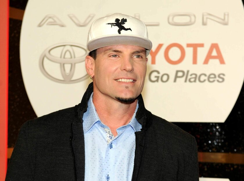FILE - In this Nov. 8, 2013 file photo, recording Artist Vanilla Ice arrives at the 2013 Soul Train Awards at the Orleans Arena in Las Vegas. Police in the Palm Beach County town of Lantana, Fla., say the recording artist and home-improvement-show host has been charged with breaking into and steali