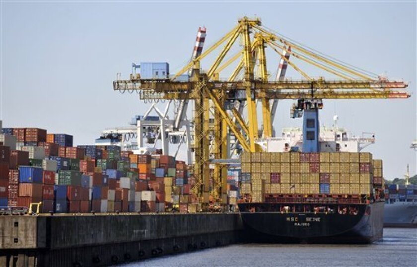 FILE - In this June 23, 2009 file picture containers are shipped in the harbour of Hamburg, Germany. Exports jumped 14.5 percent last year - the biggest rise recorded since 1950 - as economies rebounded from the global downturn, the World Trade Organization said Thursday April 7, 2011. Cross-border trade is expected to recover further in 2011, the WTO said in its annual report. Based on a 3.1 percent rise in gross domestic product worldwide, the Geneva-based body predicts exports will grow another 6.5 percent this year, slightly above the 6 percent yearly average between 1990 and 2008. (AP Photo/Axel Heimken,File)