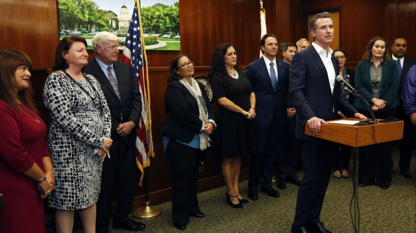 Gov. Gavin Newsom speaks after a January meeting with city leaders about providing relief and humanitarian aid to asylum seekers in San Diego.