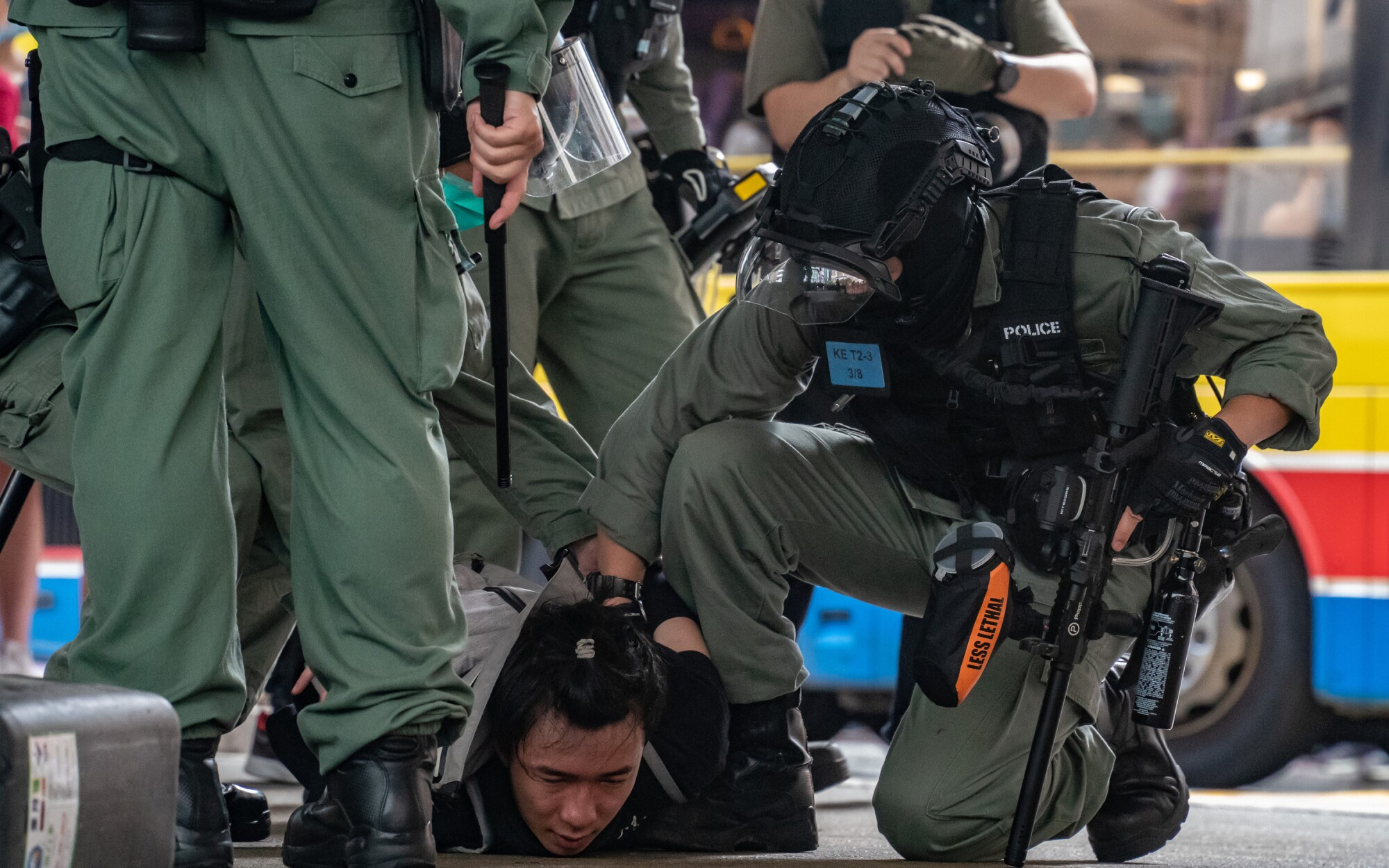 Riot police arrest a man Wednesday during a demonstration against the new national security law in Hong Kong.