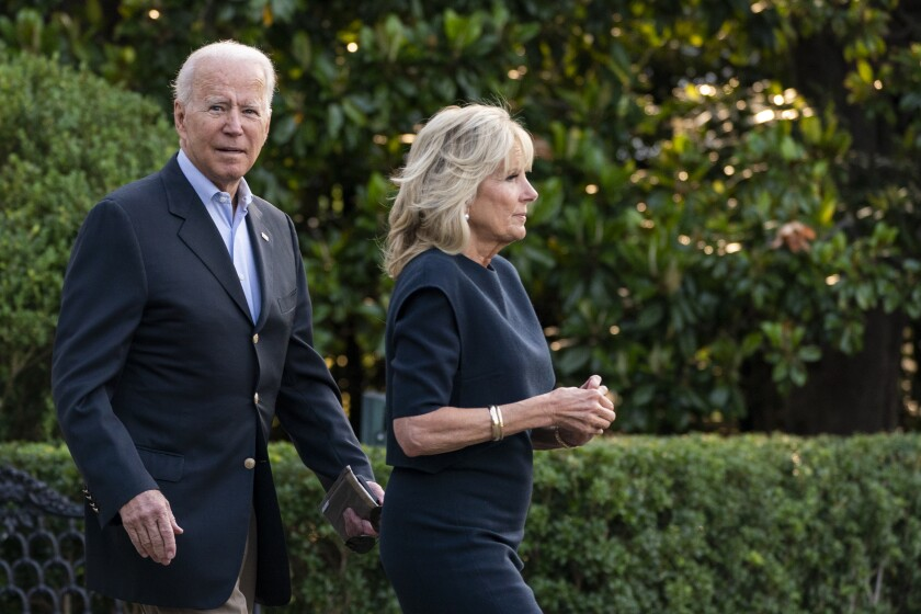 President Joe Biden and first lady Jill Biden walk on the South Lawn at the White House in Washington, Thursday, July 1, 2021, to board Marine One on their way for a brief stop to switch on Air Force One at nearby Andrews Air Force Base, Md., that will take them to Florida. (AP Photo/Manuel Balce Ceneta)