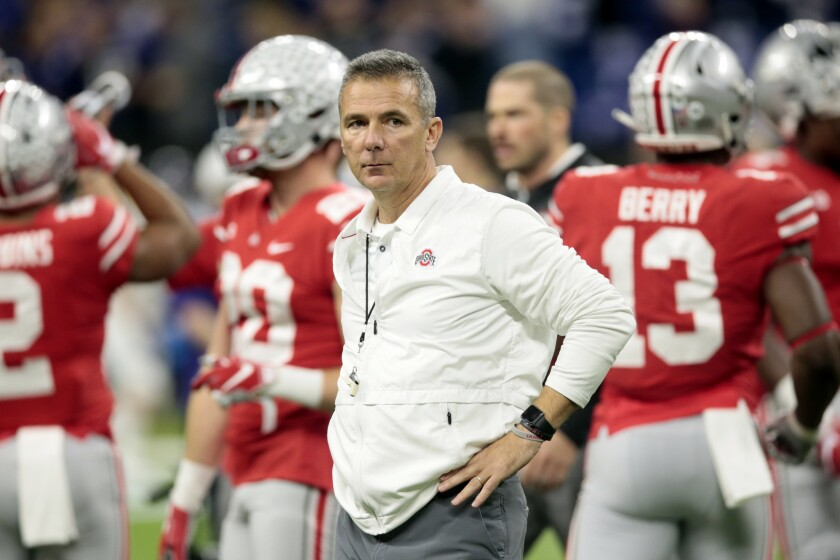 Urban Meyer watches Ohio State players warm up for the Big Ten championship game in December 2018.