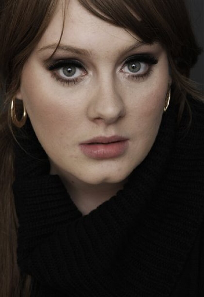 "FILE - In this Nov. 19, 2008 file photo, British singer Adele poses for a portrait in Los Angeles. Adele's song ""Rolling In the Deep,""is iTunes' top selling single, and her album ""21"" is the second top selling album of the week ending May 30, 2011. (AP Photo/Matt Sayles, file)"