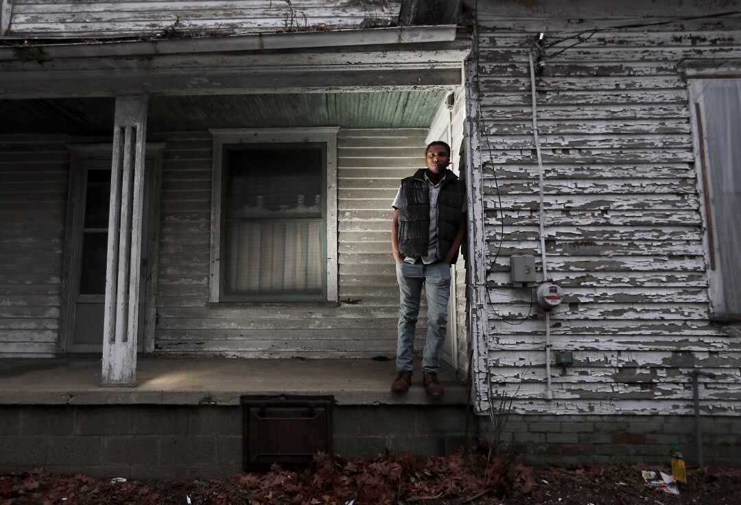 Jorden Giger, 28, a teacher and Black Lives Matter activist, outside a vacant house in the Near Northwest Neighborhood of South Bend, Ind.