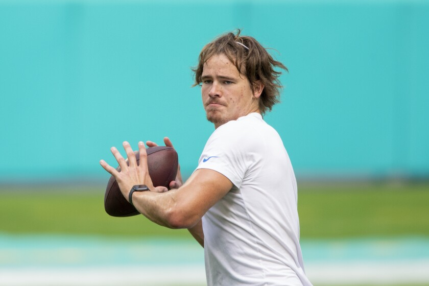 Chargers quarterback Justin Herbert warms up before Sunday's loss to the Dolphins.