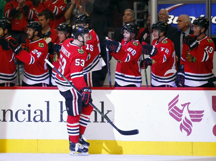 Chicago Blackhawks left wing Brandon Mashinter (53) celebrates his goal with teammates during the first period of an NHL hockey game against the Toronto Maple Leafs on Monday, Feb. 15, 2016, in Chicago. (AP Photo/Jeff Haynes)