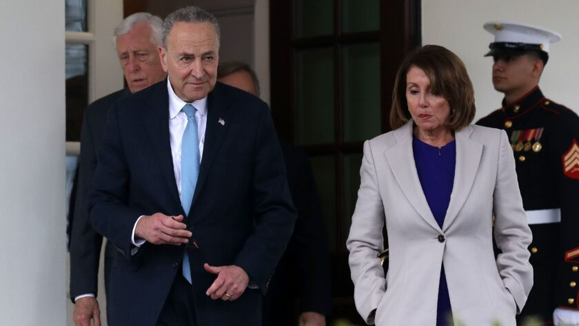 House Speaker Nancy Pelosi and Senate Minority Leader Charles E. Schumer exit the White House after meeting with President Trump to discuss the government shutdown on Friday.