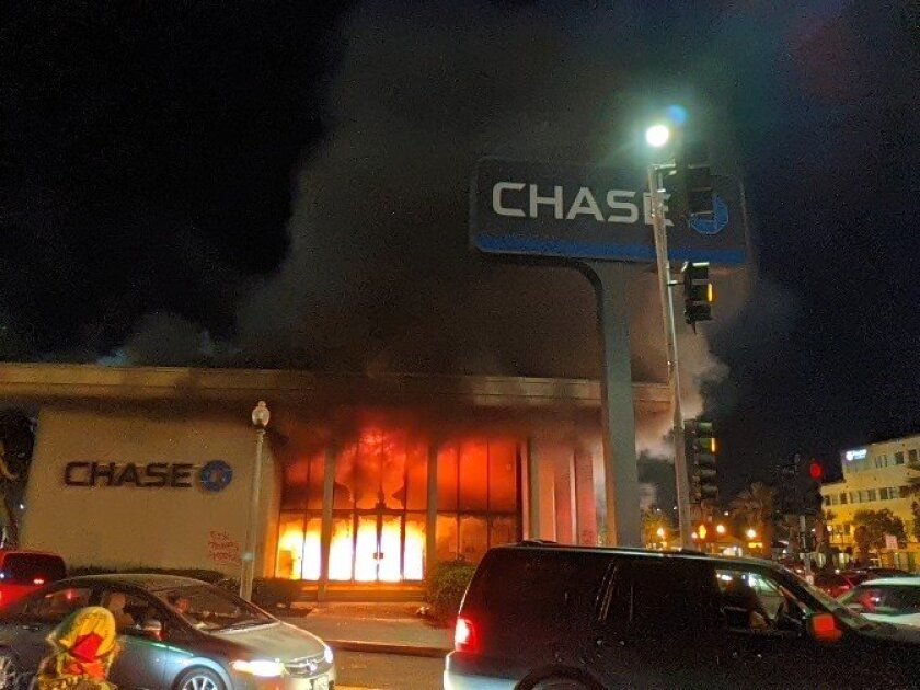 Chase bank in downtown La Mesa burns unchecked during Saturday's riot.