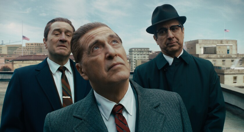 """This image released by Netflix shows, from left, Robert De Niro, Al Pacino and Ray Romano in a scene from """"The Irishman."""" On Monday, Dec. 9, 2019, Pacino was nominated for a Golden Globe for best supporting actor in a motion picture for his role in the film.(Netflix via AP)"""