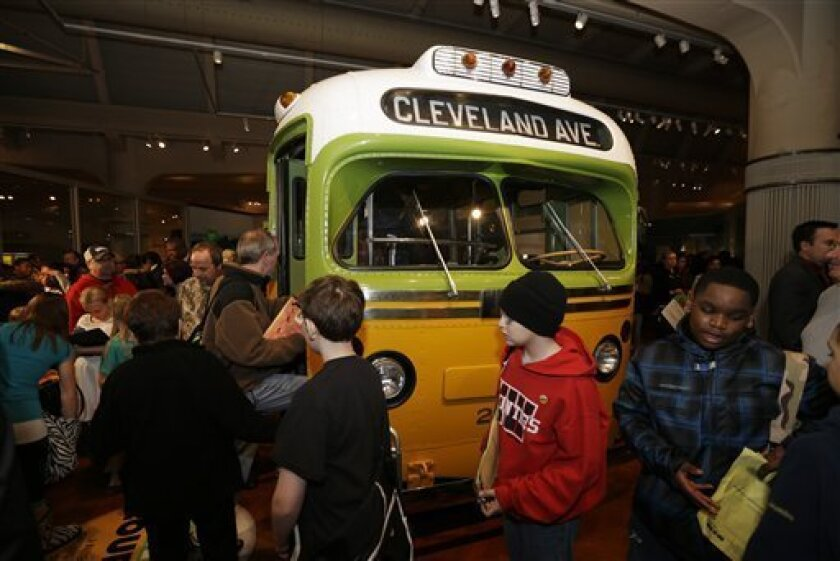 Visitors to The Henry Ford in Dearborn, Mich., board the Rosa Parks bus, Monday, Feb. 4, 2013. Earlier in the day the Rosa Parks' 100th birthday commemorative postage stamp was unveiled at the museum.(AP Photo/Carlos Osorio)