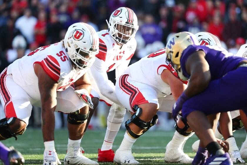 Utah quarterback Tyler Huntley prepares to snap the ball.