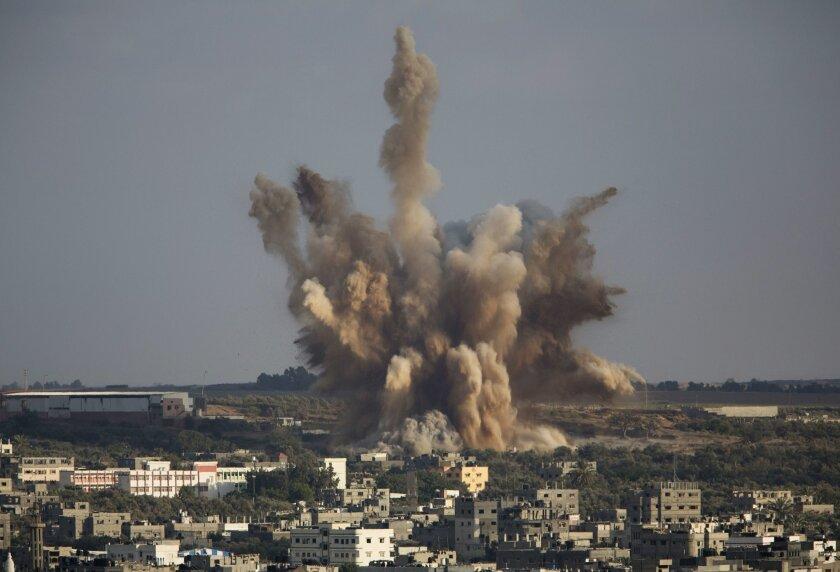 Smoke rises in Gaza City after an Israeli airstrike Saturday, Aug. 9, 2014. (AP Photo/Dusan Vranic)