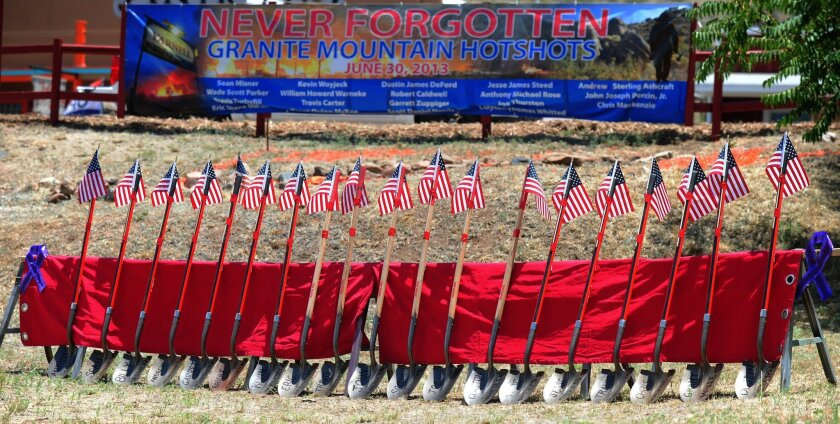 Flag-topped shovels with the names of the Granite Mountain Hotshots on their blades were a grim reminder of the tragedy that occurred two years ago as residents gathered June 28 for the Remembrance Event of the 2nd anniversary of the Yarnell Hill Fire in Arizona. Nineteen firefighters died on June 30, 2013, when the men were overrun by flames in a brush-choked canyon.