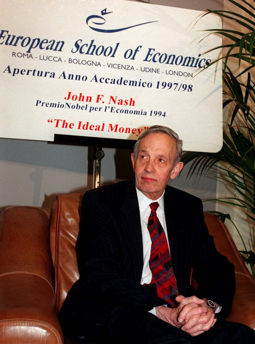 """FILE - In this Oct. 28, 1997 file photo, John Forbes Nash, 1994 Economics Nobel Prize winner, takes a break during the European School of Economics conference in Rome. Nash, the Nobel Prize-winning mathematician whose struggle with schizophrenia was chronicled in the 2001 movie """"A Beautiful Mind,"""" died in a car crash along with his wife in New Jersey on Saturday, May 23, 2015, police said. (AP Photo/Plinio Lepri, File)"""