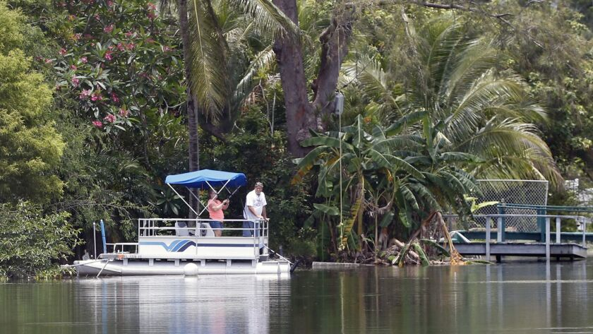 People ride a pontoon boat in Florida. American builders of recreational boats are getting caught up in President Trump's trade war.