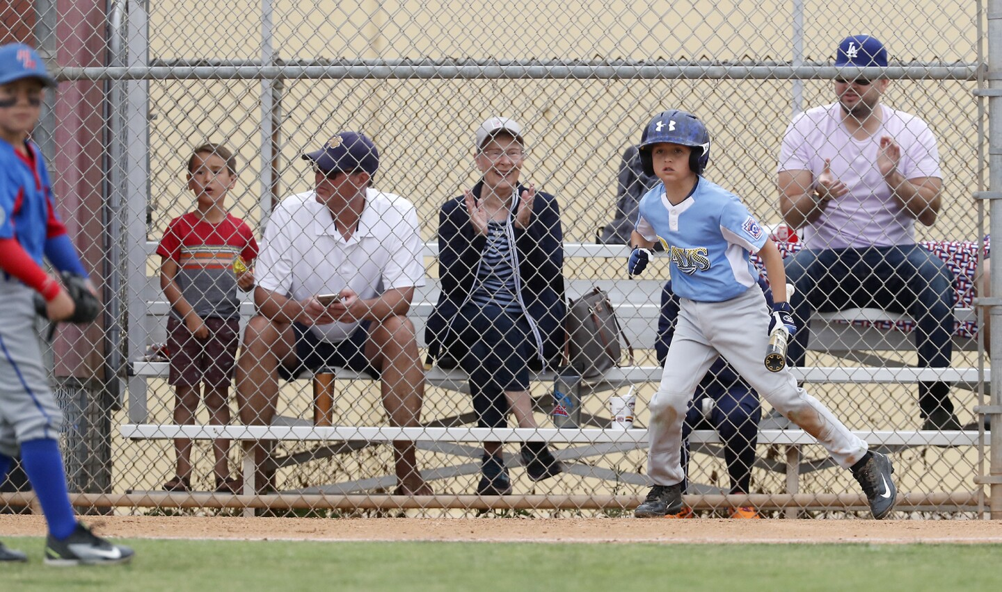 Photo Gallery: Costa Mesa American Little League vs. Huntington West Little League in the District 62 Tournament of Champions Minor B Division championship game
