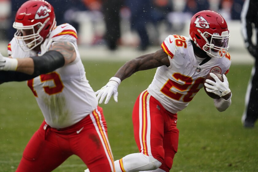 Kansas City Chiefs running back Le'Veon Bell, right, runs with the ball during the second half of an NFL football game against the Denver Broncos, Sunday, Oct. 25, 2020, in Denver. (AP Photo/David Zalubowski)