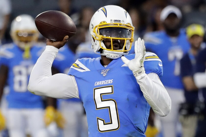 Chargers quarterback Tyrod Taylor prepares to make a pass during a game last season.