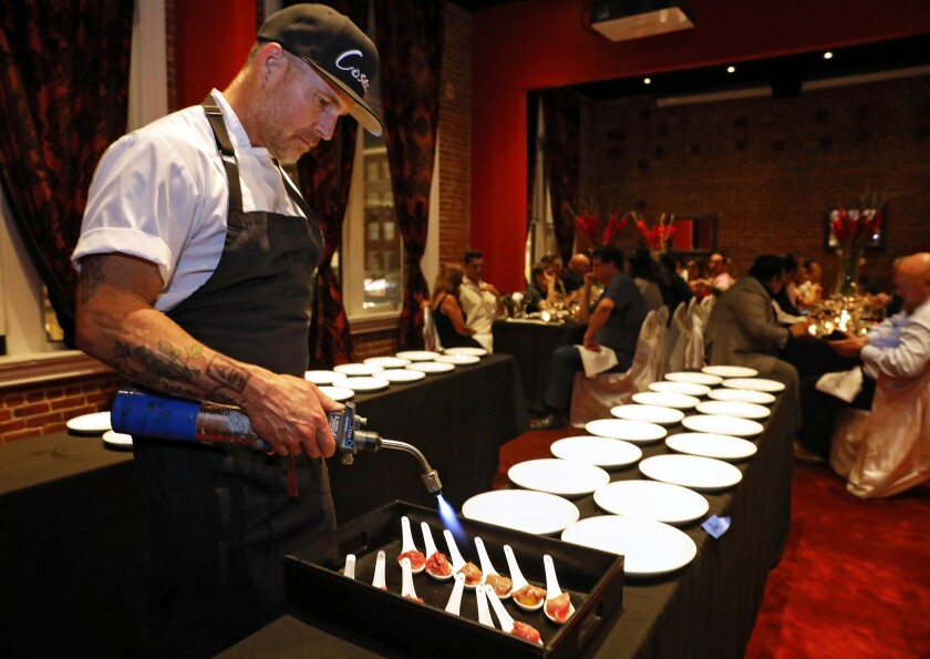 Chef Steve Brown sears a course of Wagyu tri-tip for 40 diners at a $200 Cosecha SD pop-up dinner last month at the Keating Hotel in San Diego's Gaslamp Quarter. Later this year, he'll open a permanent tasting menu-only restaurant in that location.