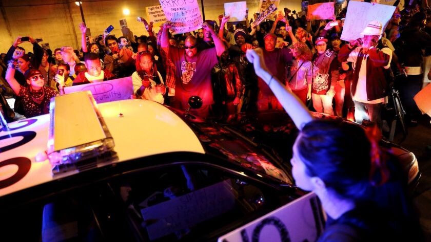 LOS ANGELES, CA. -- TUESDAY, NOVEMBER 25, 2014: Protesters surround a LAPD vehicle during the second