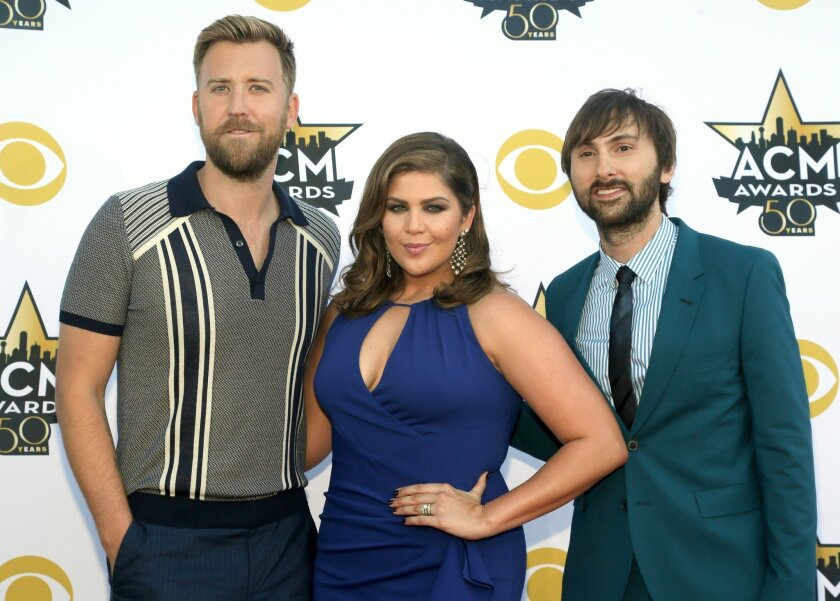 FILE - In this April 19, 2015 file photo, Charles Kelley, from left, Hillary Scott and Dave Haywood, of Lady Antebellum, arrive at the 50th annual Academy of Country Music Awards in Arlington, Texas. The group will host the 10th annual ACM Honors show, which will be televised for the first time on Aug. 30, 2016, in Nashville, Tenn. It will honor Glen Campbell, Tanya Tucker, Carrie Underwood, Keith Urban and Little Big Town. (Photo by Jack Plunkett/Invision/AP, File)