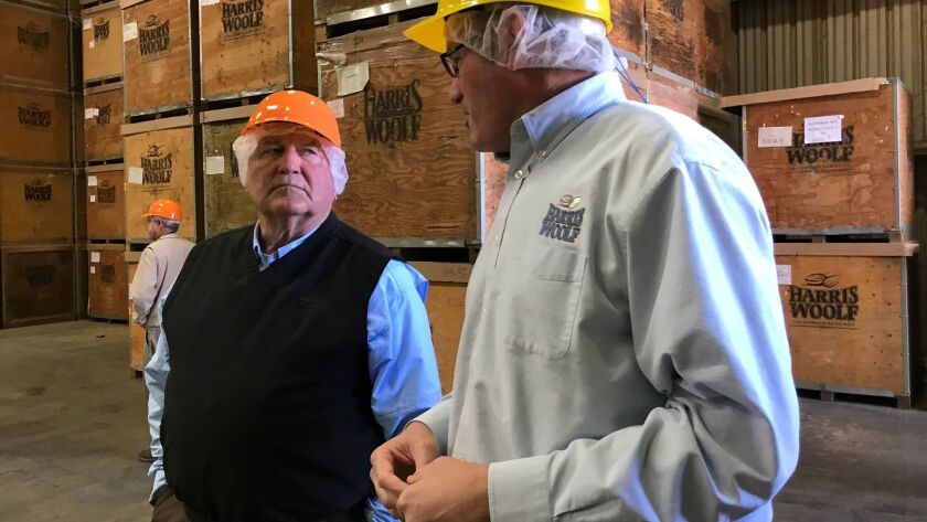Agriculture Secretary Sonny Perdue, left, with a manager [no ID available] of Harris-Woolf Almonds a