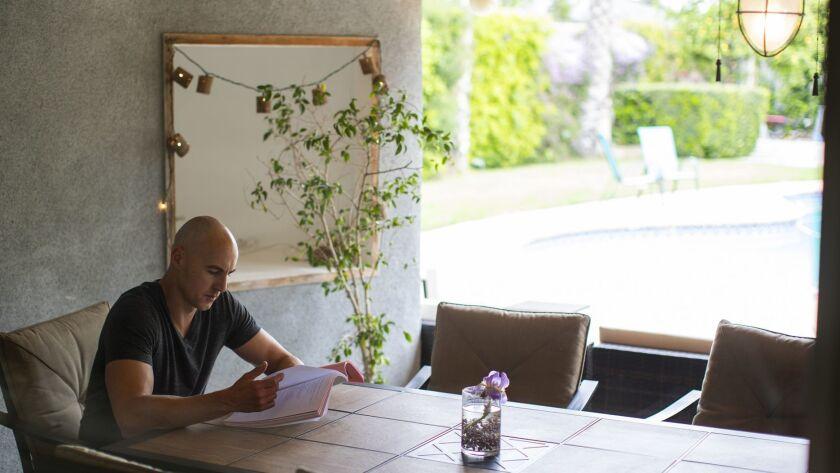 LOS ANGELES, CA - APRIL 11, 2019: Actor Douglas Tait studies a script in his favorite room, the outd
