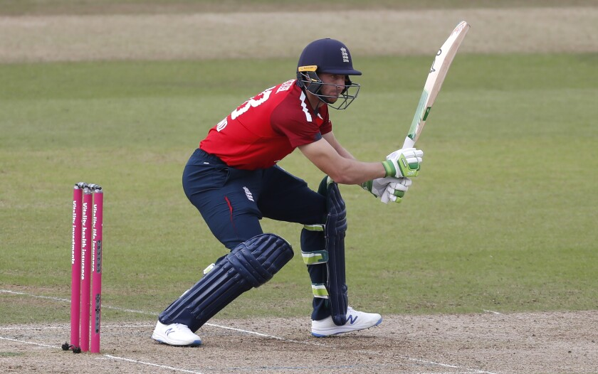 England's Jos Buttler bats during the second Twenty20 cricket match between England and Australia, at the Ageas Bowl in Southampton, England, Sunday, Sept. 6, 2020. (Paul Childs/Pool via AP)