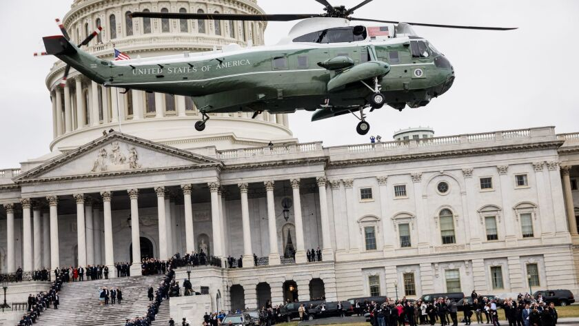 Barack and Michelle Obama leave the Capitol.
