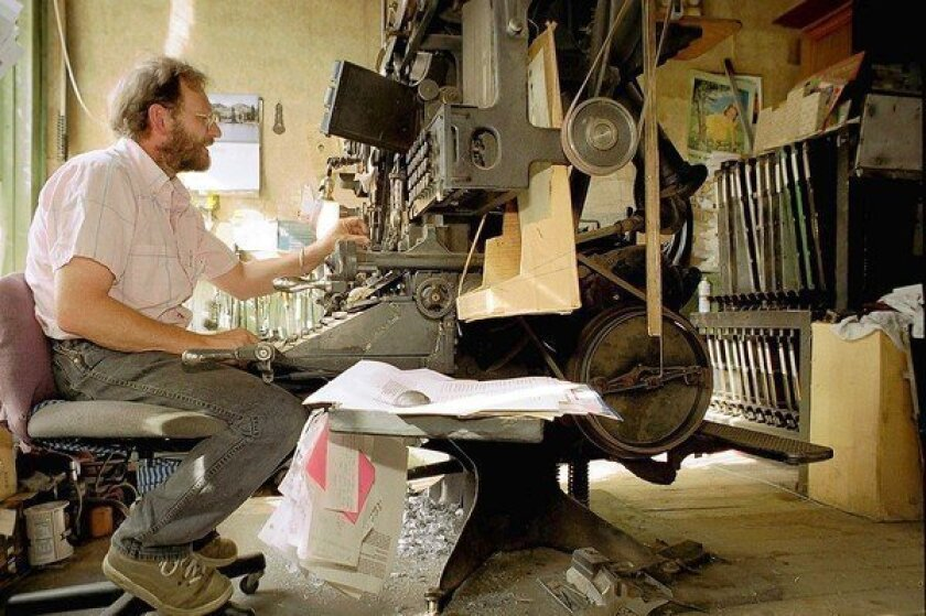 Dean Coombs, publisher of the Saguache Crescent in Saguache, Colo., sets type in 2001 on an antique Linotype machine, which he still uses to put out his paper.