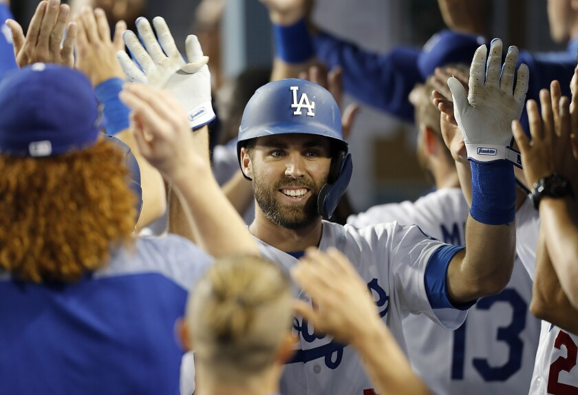 Dodgers left fielder Chris Taylor is congratulated by teammates.