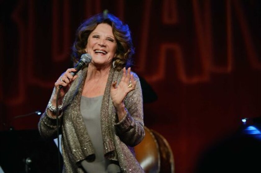 """This Monday, Feb. 25, 2013 photo released by the Pulmonary Fibrosis Foundation shows actress Linda Lavin performing at the third annual """"Broadway Belts for PFF!"""" a benefit for the Pulmonary Fibrosis Foundation at the Birdland Jazz Club in New York. (AP Photo/Pulmonary Fibrosis Foundation, Chris Owy"""