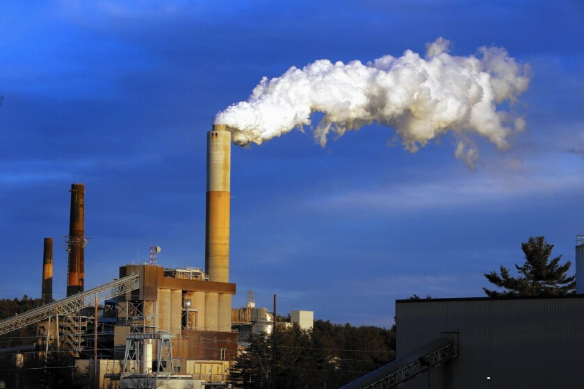 Steam billows from the coal-fired Merrimack Station in Bow, N.H. President Obama's Clean Power Plan poses significant challenges for states that rely on coal-fired power plants for much of their electricity.