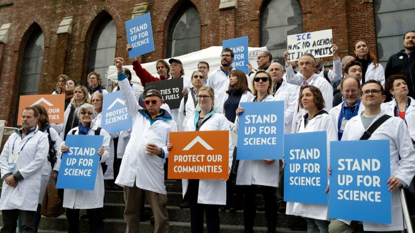 Scientists rally in San Francisco on Dec. 13, in an attempt to call attention to what they believe are unwarranted attacks by the incoming Trump administration against researchers advocating for the issue of climate change and its impacts.