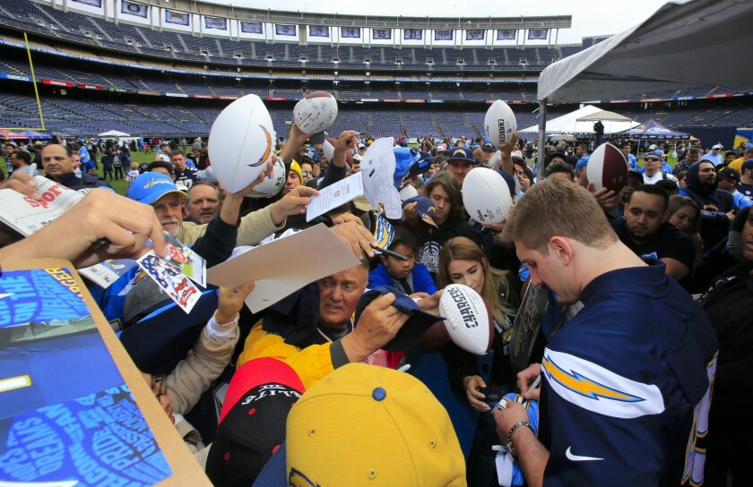 Defensive end, Joey Bosa,  the first round draft pick, signs autographs for Chargers fans during DraftFest at Qualcomm Stadium.