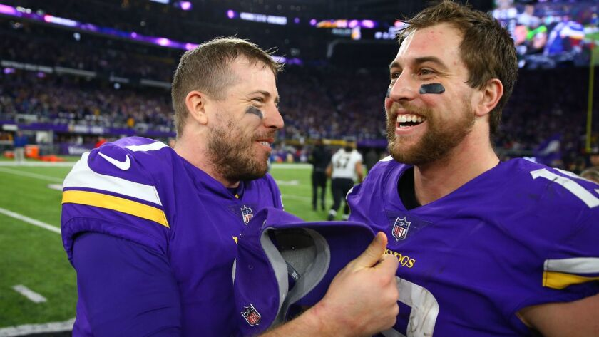 Vikings quarterback Case Keenum (left) celebrates with wide receiver Adam Thielen after defeating the Saints in the NFC divisional round.