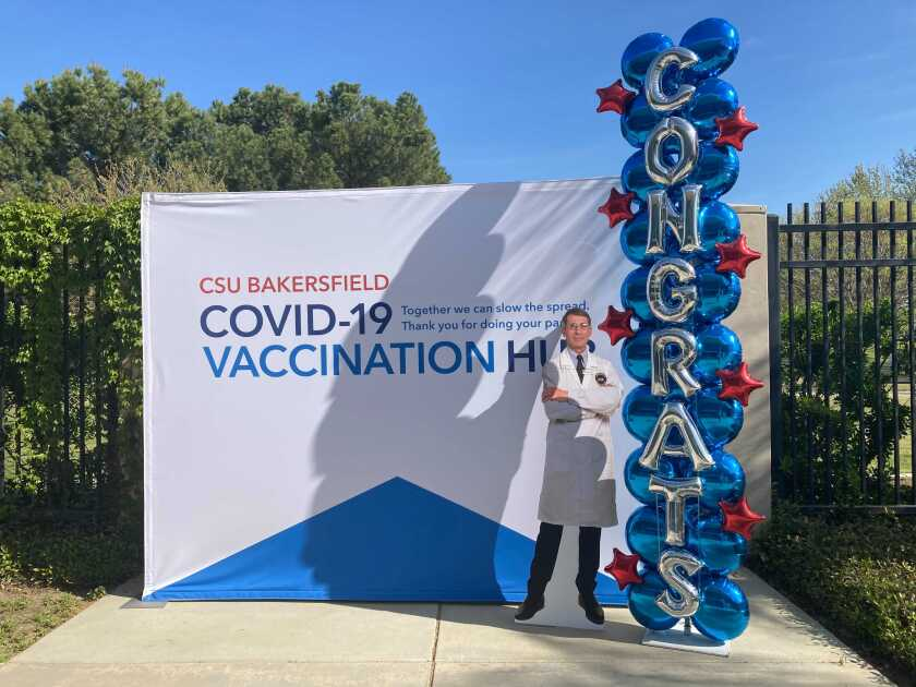 People who get vaccines can pose with a cutout of Dr. Anthony Fauci at the CSU Bakersfield vaccination site in Bakersfield.