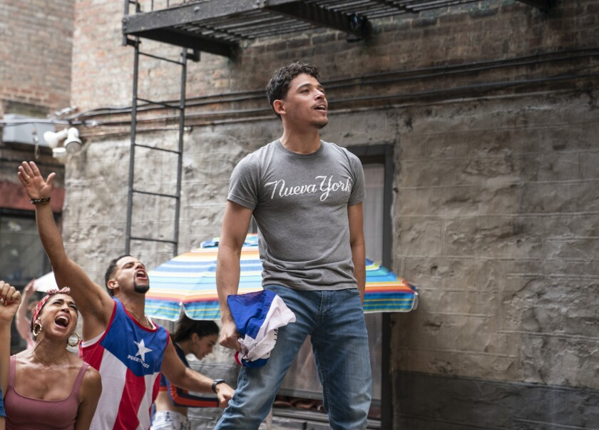 """This image released by Warner Bros. Pictures shows Anthony Ramos in a scene from """"In the Heights."""" (Macall Polay/Warner Bros. Pictures via AP)"""
