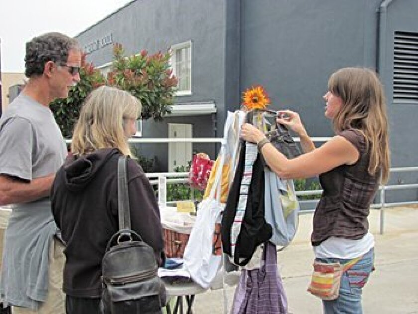 Customer check out the goodies at a recent La Jolla Open Aire Market. Photo: Susan DeMaggio