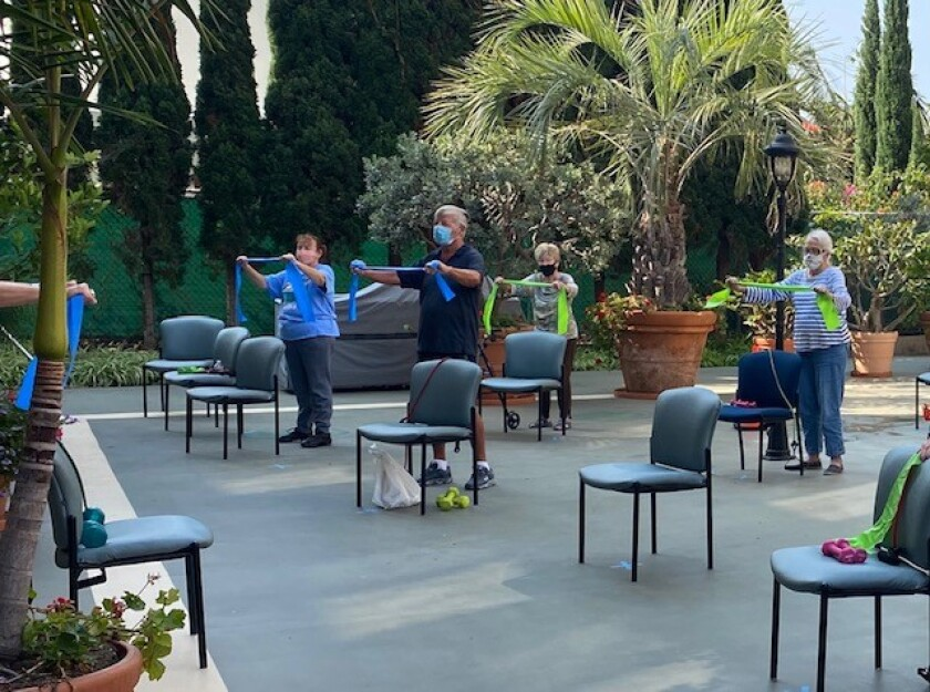 Chateau La Jolla residents participate in an outdoor exercise class.