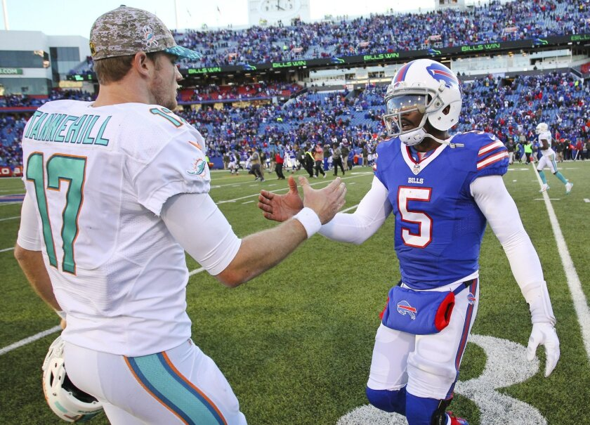 Buffalo Bills quarterback Tyrod Taylor (5) greets Miami Dolphins quarterback Ryan Tannehill (17) after an NFL football game, Sunday, Nov. 8, 2015, in Orchard Park, N.Y. The Bills won the game 33-17. (AP Photo/Bill Wippert)