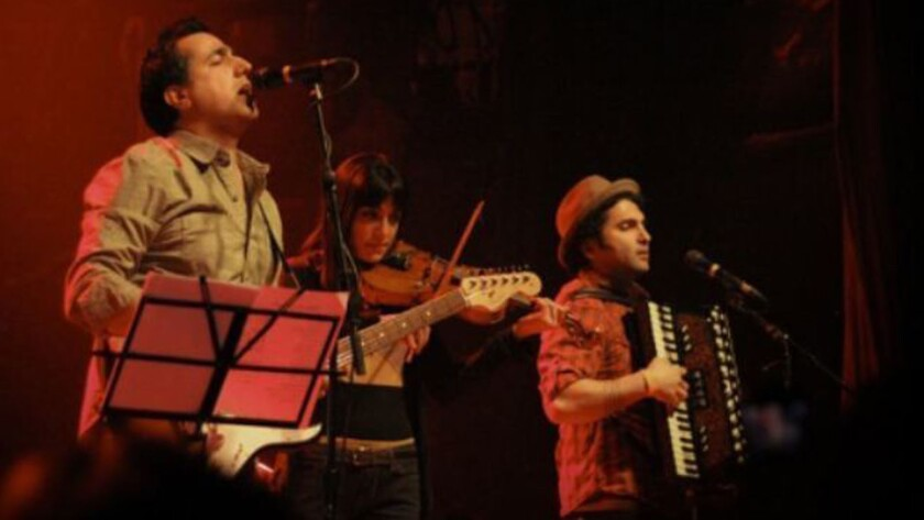 Arash Sobhani, left, violinist Tara Kamangar and accordionist Ardalan Payvar of Iranian rock band Kiosk, shown performing in Toronto in 2012, are set to perform March 22 at LACMA. Not pictured: bassist Ali Kamali.