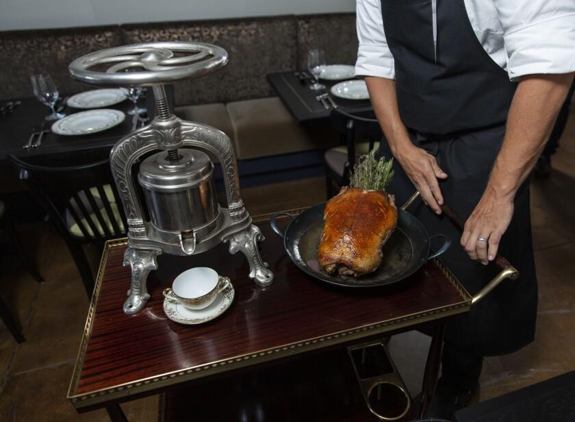 Tableside pressed duck at Pasjoli