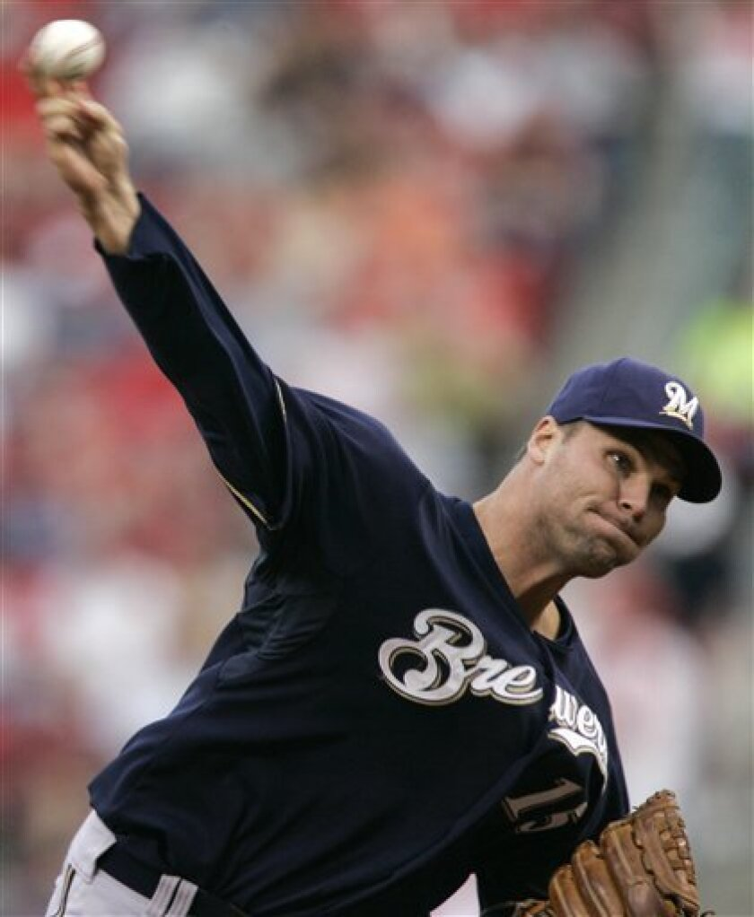 Milwaukee Brewers pitcher Ben Sheets pitches against the Cincinnati Reds in the first inning of a baseball game, Friday, April 18, 2008, in Cincinnati. (AP Photo/Al Behrman)