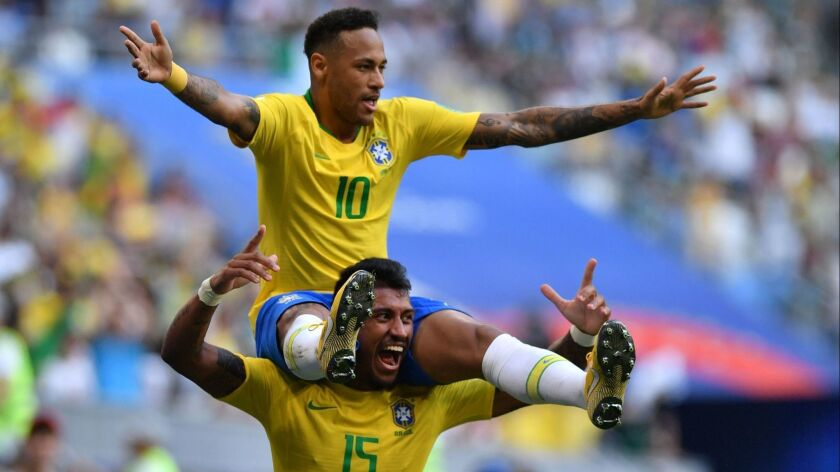 Brazil's forward Neymar celebrates with midfielder Paulinho after scoring the opening goal during the Russia 2018 World Cup round of 16 football match between Brazil and Mexico at the Samara Arena in Samara on Monday.