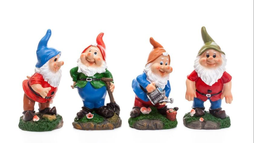 Four Garden Gnomes isolated on white background, simple figurines to decorate your garden
