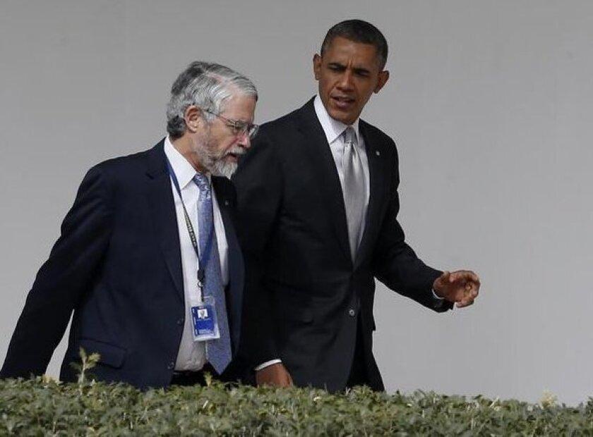 John Holdren talks with President Obama