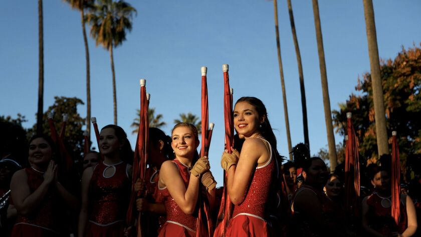 Abby Taylor, left, and Macey Glassco of the Albertville High School Band of Albertville, Ala., take in the excitement before the start of the Rose Parade.