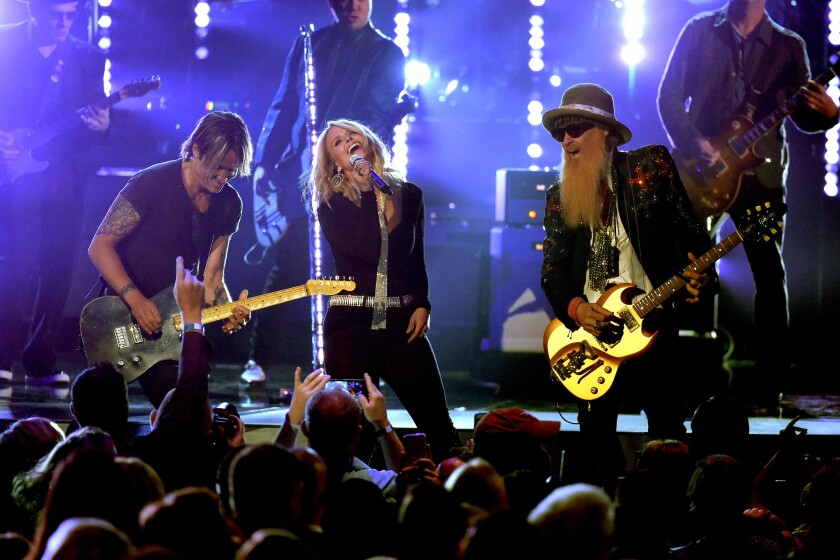 Keith Urban, left, Miranda Lambert and Billy Gibbons onstage at the 51st ACM Awards.